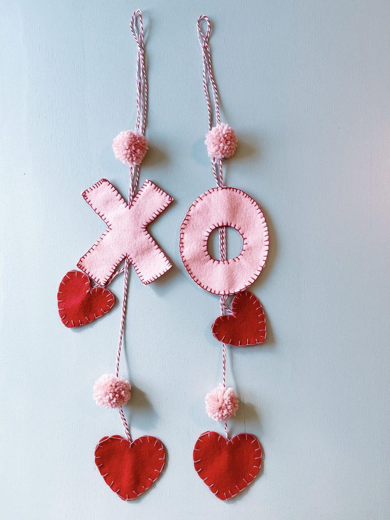 X O felt cabinet hangers